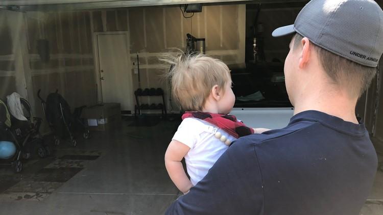 Matthew Eschrich and son inspecting the garage