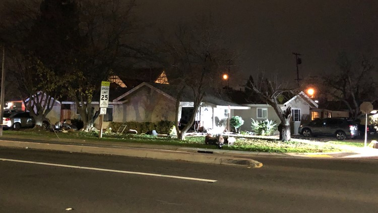 The scene after a car crashed into a Rancho Cordova home on Sunday evening, leaving one person dead and two others injured.