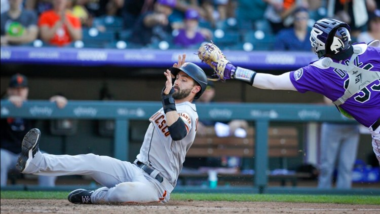 Giants hold NL West lead, top Rockies; Belt's hand injured