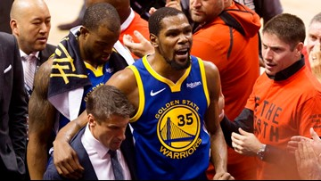 Durant injured, Warriors lead 62-56 at halftime