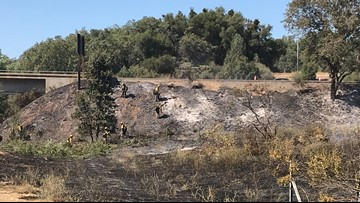 Fire crews put out grass fire on Highway 50 near Placerville