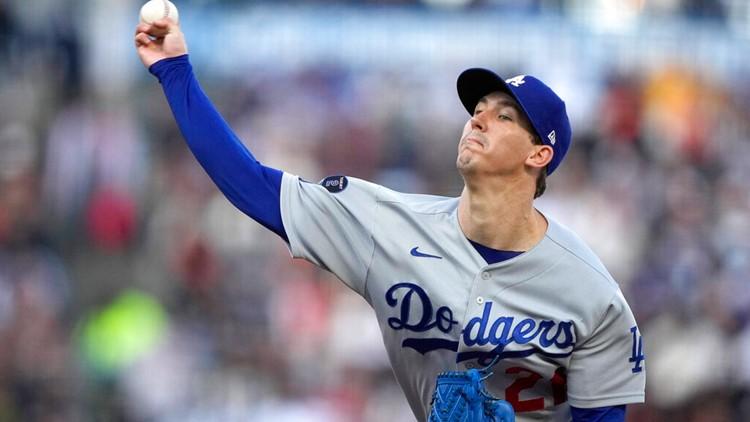 Buehler, Dodgers dominate 1st-place Giants 8-0