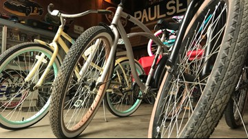 'Put some smiles on their face' | Volunteers help refurbish bikes for kids in need this Christmas