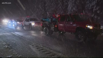 Snowstorm snarls traffic on I-80, closes schools in the Sierra