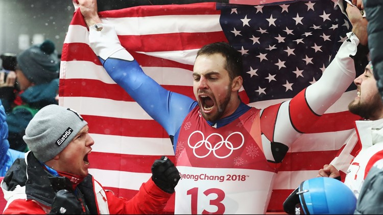 Chris Mazdzer of the United States celebrates winning the silver medal following run 4 during the Luge Men's Singles on day two of the PyeongChang 2018 Winter Olympic Games at Olympic Sliding Centre on February 11, 2018.
