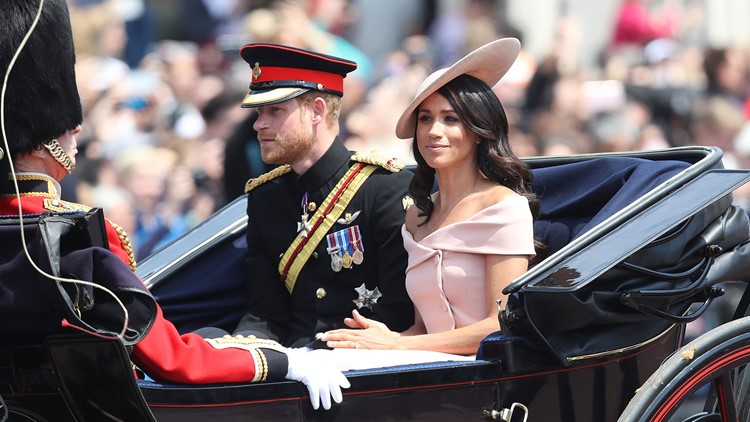 Prince Harry, Duke of Sussex and Meghan, Duchess of Sussex head back down the Mall to Buckingham Palace during Trooping The Colour on June 9, 2018 in London, England.