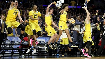 "Michigan advances to NCAA championship game, snuffing Loyola's ""Cinderella"" run"
