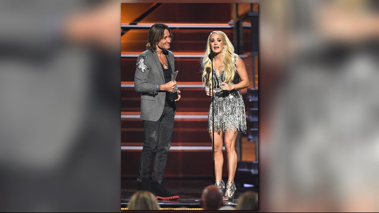 Keith Urban (L) and Carrie Underwood accept the Vocal Event of the Year award for 'The Fighter' onstage during the 53rd Academy of Country Music Awards at MGM Grand Garden Arena on April 15, 2018 in Las Vegas, Nevada.