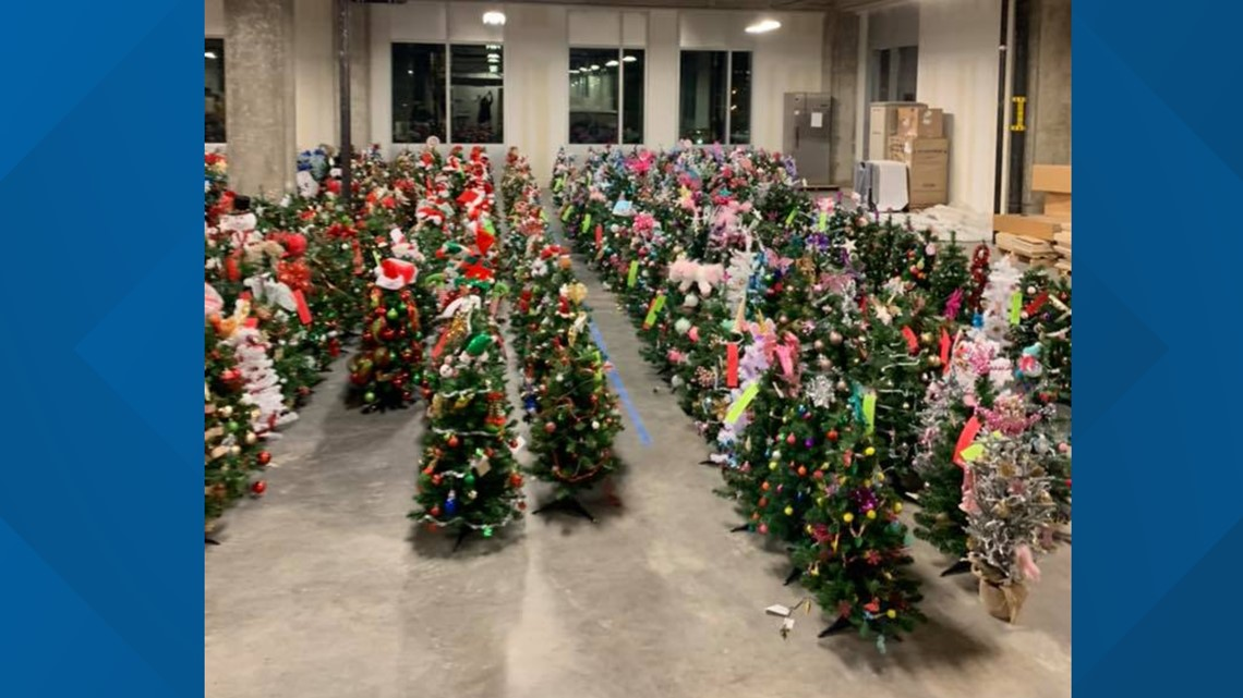 Volunteers drop off hundreds of tiny decorated trees for tiny patients at ETCH
