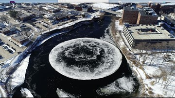 Giant ice disk floating, rotating in Westbrook's Presumpscot River