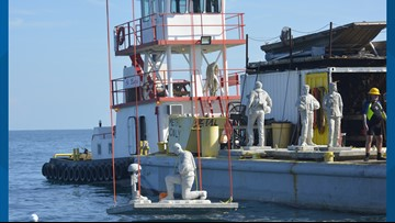 Statues lowered 40 feet underwater in Gulf of Mexico for 1st dive memorial honoring U.S. veterans