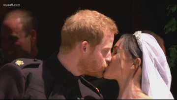 Prince Harry and Meghan Markle share a kiss as they exit St. George's Chapel