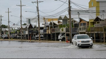 Weakened Barry rolls into Louisiana, drenches Gulf Coast